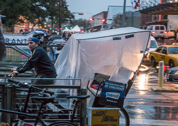 Pedicab driver in rain