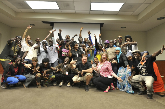 "Macklin, Cunningham and Babaluku pose with a crowd of attendees at the ""Masizhake"" screening at the U.S. Embassy, Kampala."