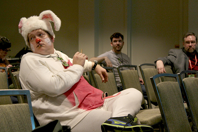 "A costumed panel attendee sits in on the ""Comics and Digital Culture Series."""