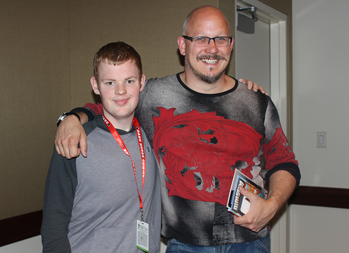Madefire's Liam Sharp poses with an attendee after the day's last panel.