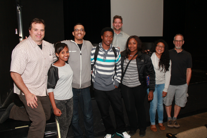 "Scott Macklin (far left) poses with the Black Student Union and faculty advisors of Chief Sealth International High School after the club's premiere of ""Riffing on the Dream."""