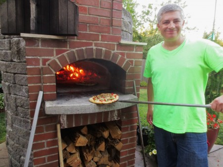 Jeff Barr with his backyard wood-fired pizza oven. All photos courtesy of Barr.