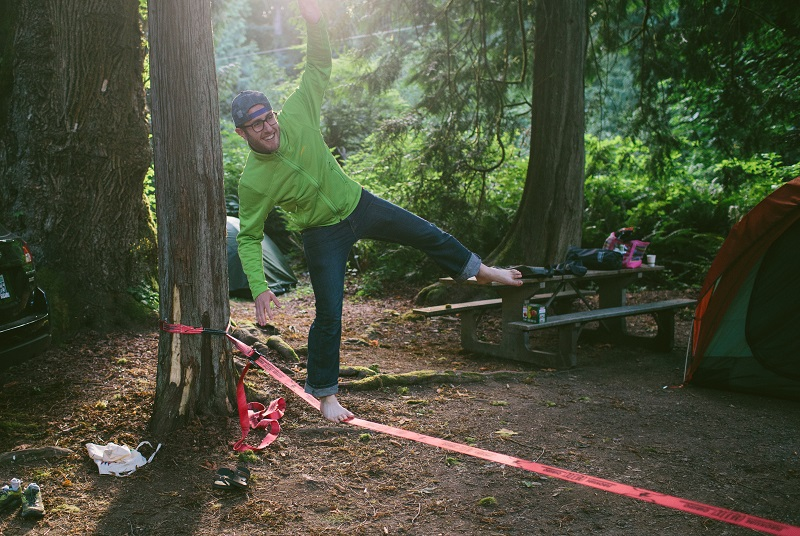 Paolo Motolo, Cohort 8, on a slackline at an REI team retreat.