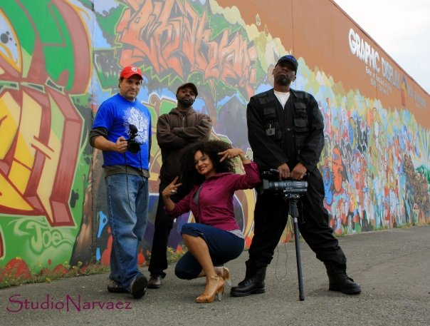 Scott Macklin (left) poses with the crew while filming - next to Macklin is Mike Clark, Laura Piece Kelly, and Georgio Brown (right). Photo by Pablo D. Narvaez